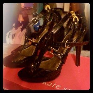 Black high heels ...gold chains.